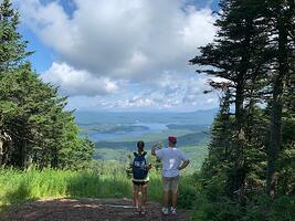 Family Hiking To Top of Mt Snow